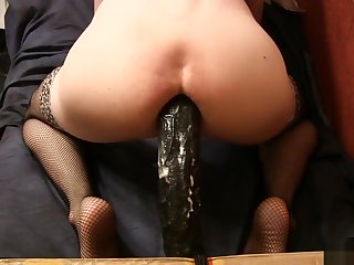 Sissy on a big black toy