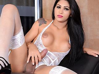 Seductive Raven Haired TS Larissa Albuquerque Fucks Her Ass with a Dildo