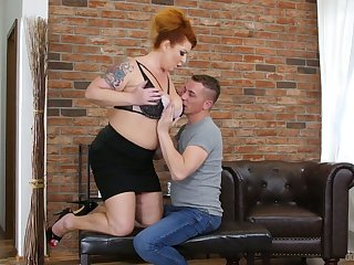 Tattooed giant breasted redhead is mature bitch who loves to ride dick