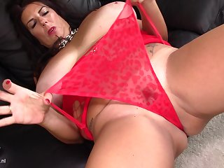 Kinky Lulu takes out her big tits before she masturbates passionately
