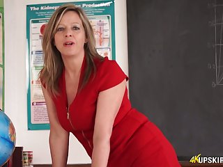 Slutty teacher in short red dress Lou Pierce teases with yummy twat upskirt