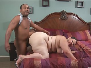 Chubby woman deals black man's huge cock in absolute passion