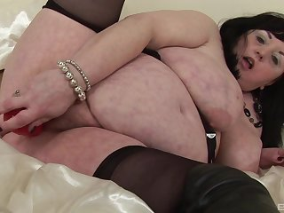 Brunette mature amateur with giant saggy boobs masturbating