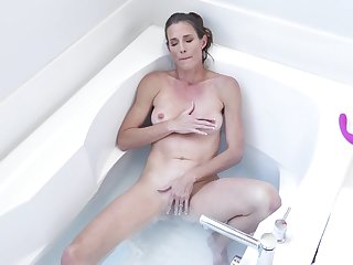 Solo woman treats herself with some nice toying in the tub